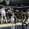 Photo -   Utah Jazz's Gordon Hayward (20) and Al Jefferson (25) go to the basket against Memphis Grizzlies center Marc Gasol (33), of Spain, and forward Rudy Gay (22) in the first half of an NBA basketball game, Monday, Nov. 5, 2012, in Memphis, Tenn. (AP Photo/Lance Murphey)