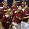 OU\'s Javen Henson, second from right, along with other Oklahoma softball players walk off the field after losing 6-2 in a Women\'s College World Series game between the University of Oklahoma and Alabama at ASA Hall of Fame Stadium in Oklahoma City Thursday, May 29, 2014. Photo by Bryan Terry, The Oklahoman