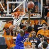 Photo - Kansas guard Andrew Wiggins (22) shoots in front of Oklahoma State post Kamari Murphy (21) in the second half of an NCAA college basketball game in Stillwater, Okla., Saturday, March 1, 2014. Oklahoma State won 72-65. (AP Photo/Sue Ogrocki)