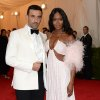 """Riccardo Tisci, left, and Naomi Campbell attend The Metropolitan Museum of Art\'s Costume Institute benefit gala celebrating """"Charles James: Beyond Fashion"""" on Monday, May 5, 2014, in New York. (Photo by Evan Agostini/Invision/AP)"""