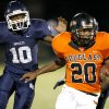 Aliston Cobb of Douglass runs past Star Spencer\'s Carlos Hutson during the finals of the All-City Athletic Conference Football Preview at Moses F. Miller Stadium in Oklahoma City, Friday, August 27, 2010. PHOTO BY BRYAN TERRY, THE OKLAHOMAN