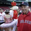Photo -   Boston Red Sox manager Bobby Valentine, right, talks with fans as a Nutcracker ballerina and soldier walk along the first base line prior to a baseball game against the Baltimore Orioles at Fenway Park in Boston, Friday, Sept. 21, 2012. (AP Photo/Charles Krupa)