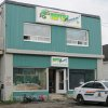 Photo - In this Monday Aug. 5, 2013 photo, Royal Canadian Mounted Police work at the scene of a fatal python attack at Reptile Ocean exotic pet store in Campbellton, New Brunswick. Two young boys were killed by a python snake as they slept in an apartment above the store. (AP Photo/The Canadian Press)