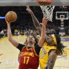 Photo - Cleveland Cavaliers center Anderson Varejao, left, of Brazil, puts up a shot as Los Angeles Lakers center Jordan Hill defends during the first half of an NBA basketball game, Tuesday, Jan. 14, 2014, in Los Angeles. (AP Photo/Mark J. Terrill)