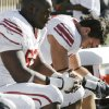 OU\'s Gerald McCoy (93), left, and Austin Box (12) sit on the bench late in the fourth quarter during the college football game between the University of Oklahoma Sooners (OU) and the Texas Tech University Red Raiders (TTU) at Jones AT&T Stadium in Lubbock, Texas, Saturday, Nov. 21, 2009. Texas Tech won, 41-13. Photo by Nate Billings, The Oklahoman