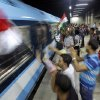 In this image made late Wednesday, July 3, 2013, opponents of Egypt\'s Islamist leader Mohammed Morsi wave national flags to a passing underground train as they celebrate Morsi\'s ouster in Cairo, Egypt. The chief justice of Egypt\'s Supreme Constitutional Court was sworn in Thursday as the nation\'s interim president, taking over hours after the military ousted the Islamist President Mohammed Morsi. Adly Mansour took the oath of office at the Nile-side Constitutional Court in a ceremony broadcast live on state television. According to military decree, Mansour will serve as Egypt\'s interim leader until a new president is elected. A date for that vote has yet to be set. (AP Photo/Amr Nabil)