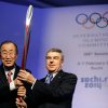 Photo - United Nations Secretary-General Ban Ki-moon, left, is presented with an Olympic torch by International Olympic Committee President Thomas Bach, right, after Ban addressed the IOC's general assembly ahead of the upcoming 2014 Winter Olympics, Thursday, Feb. 6, 2014, in Sochi, Russia. It was the first time a U.N. secretary-general delivered a keynote address to the IOC's general assembly. (AP Photo/David Goldman)