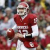 Oklahoma\'s Landry Jones (12) scrambles during a college football game between the University of Oklahoma Sooners (OU) and the Iowa State University Cyclones (ISU) at Gaylord Family-Oklahoma Memorial Stadium in Norman, Okla., Saturday, Nov. 26, 2011. Photo by Bryan Terry, The Oklahoman