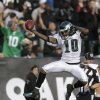 Photo - FILE - In this Nov. 3, 2013 file photo, Philadelphia Eagles wide receiver DeSean Jackson (10) celebrates as he scores on a 46-yard touchdown pass from quarterback Nick Foles during the third quarter of an NFL football game against the Oakland Raiders in Oakland, Calif. The Washington Redskins made their biggest move yet of the offseason Tuesday night, April 1, 2014, adding three-time Pro Bowl receiver DeSean Jackson less than a week after the dynamic playmaker was released by the rival Philadelphia Eagles. (AP Photo/Marcio Jose Sanchez, File)