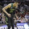 Baylor center Isaiah Austin winces after a play against Creighton during the first half of a third-round game in the NCAA college basketball tournament Sunday, March 23, 2014, in San Antonio. (AP Photo/Eric Gay)