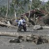 A survivor retrieves his motorcycle from his home destroyed by a flash flood caused by Typhoon Bopha, Thursday Dec. 6, 2012 at New Bataan township, Compostela Valley in southern Philippines. The powerful typhoon that washed away emergency shelters, a military camp and possibly entire families in the southern Philippines has killed hundreds of people with nearly 400 missing, authorities said Thursday. (AP Photo/Bullit Marquez)