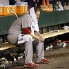 St. Louis Cardinals starting pitcher Lance Lynn sits on the bench after being pulled from the game during the fourth inning of Game 1 of baseball\'s National League championship series against the San Francisco Giants Sunday, Oct. 14, 2012, in San Francisco. (AP Photo/David J. Phillip)