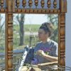 Kristi McDaniel-Edwards is reflected in the dresser mirror of her grandmother Louise McDaniel\'s home as residents cleanup following Tuesday\'s deadly tornado on Wednesday, May 25, 2011, in Chickasha, Okla. Louise was with her hospitalized son Ronnie McDaniel in Oklahoma City when the tornado destroyed her home. Louise McDaniel saw the destruction and recognized her yard from aerial television coverage. Photo by Steve Sisney, The Oklahoman