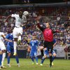Photo - Ivory Coast forward Lacina Traore (18) fails to convert a header past Bosnia goalkeeper Asmir Begovic on a corner kick in the first half of a soccer game Friday, May 30, 2014, in St. Louis. (AP Photo/St. Louis Post-Dispatch, Chris Lee) EDWARDSVILLE OUT  ALTON OTU