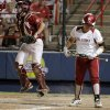 Oklahoma\'s Georgia Casey (42) walks away after striking out as Alabama\'s Kendall Dawson (12) celebrates in the sixth inning during the championship game of the Women\'s College World Series as ASA Stadium in Oklahoma City, Tuesday, June 5, 2012. Photo by Bryan Terry, The Oklahoman