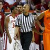 Oklahoma\'s Steven Pledger (2) and Carl Blair (14) celebrate beside Oklahoma State\'s Brian Williams (4) during the Bedlam men\'s college basketball game between the University of Oklahoma Sooners and the Oklahoma State Cowboys in Norman, Okla., Wednesday, Feb. 22, 2012. Oklahoma won 77-64. Photo by Bryan Terry, The Oklahoman