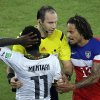 Referee Jonas Eriksson from Sweden, center, mediates an argument between Ghana\'s Sulley Muntari, left, and United States\' Jermaine Jones during the group G World Cup soccer match between Ghana and the United States at the Arena das Dunas in Natal, Brazil, Monday, June 16, 2014. (AP Photo/Hassan Ammar)