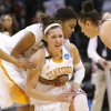 Tennesse\'s Taber Spani, front, and Kamiko Williams, back, react to loosing to Louisville in the Oklahoma City regional final game in the women\'s NCAA college basketball tournament in Oklahoma City, Tuesday, April 2, 2013. Louisville own 86-78. (AP Photo/Alonzo Adams)
