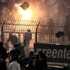 Photo - Panathinaikos and PAOK fans clash each other shortly before the start of the Greek championship play-off match between their teams at Apostolos Nikolaidis stadium in Athens, Sunday, May 4, 2014. (AP Photo/InTime Sports)  GREECE OUT