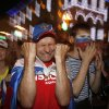 In this photo taken late Saturday, June 16, 2012, Russian soccer fans react as they watch the Euro 2012 soccer championship Group A match between Greece and Russia in Kiev, Ukraine. (AP Photo/Sergei Grits)