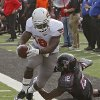 Oklahoma State\'s Herschel Sims (18) runs past Texas Tech Red Raiders safety D.J. Johnson (12) during the college football game between the Oklahoma State University Cowboys (OSU) and Texas Tech University Red Raiders (TTU) at Jones AT&T Stadium on Saturday, Nov. 12, 2011. in Lubbock, Texas. Photo by Chris Landsberger, The Oklahoman ORG XMIT: KOD