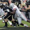 Photo - Ohio State defensive lineman Noah Spence, right, sacks Purdue quarterback Danny Etling during the first half of an NCAA college football game in West Lafayette, Ind., Saturday, Nov. 2, 2013. (AP Photo/Michael Conroy)