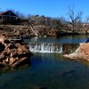 Medicine Creek offers a scenic setting for fishing even if the trout don\'t bite. Medicine Creek in Medicine Park is Oklahoma\'s newest winter only trout fishery. Trout fishing will be available at Medicine Creek through mid-March. Photo by Donny Carter