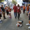 OU fans Julia and Beau Garland of Tulsa drag a Bevo doll past Texas fans before the Red River Rivalry college football game between the University of Oklahoma Sooners and the University of Texas Longhorns at the Cotton Bowl Stadium in Dallas, Saturday, Oct. 12, 2013. Photo by Bryan Terry, The Oklahoman