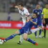 Greece\'s Giannis Maniatis, right, tries to stop Bosnia-Herzegovina\'s Edin Dzeko during their World Cup Group G qualifying soccer match at the Karaiskaki stadium in Piraeus port, near Athens, Thursday, Oct. 11, 2012. (AP Photo/Thanassis Stavrakis)