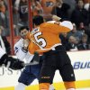 Toronto Maple Leafs\' Mike Brown, left, and Philadelphia Flyers\' Tye McGinn fight in the first period of an NHL hockey game, Monday, Feb 25, 2013, in Philadelphia. (AP Photo/Michael Perez)