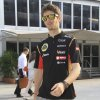 Photo - Lotus driver Romain Grosjean of France arrives at the paddock for a practice session ahead of the Malaysian Formula One Grand Prix at Sepang International Circuit in Sepang, Malaysia, Friday, March 28, 2014. (AP Photo/Peter Lim)