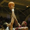 Photo - Duke's Shelden Williams (23) tries to block Florida State's Al Thornton during the first half of their college basketball game Saturday, Feb. 4, 2006 in Durham, N.C. (AP Photo/Sara D. Davis)