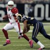 Arizona Cardinals quarterback Kevin Kolb, left, scrambles as he is sacked by St. Louis Rams cornerback Bradley Fletcher during the first quarter of an NFL football game, Thursday, Oct. 4, 2012, in St. Louis. (AP Photo/L.G. Patterson)