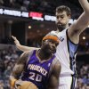 Photo - Phoenix Suns' Jermaine O'Neal (20) works the ball around Memphis Grizzlies' Marc Gasol, of Spain, during the first half of an NBA basketball game in Memphis, Tenn., Tuesday, Dec. 4, 2012. (AP Photo/Danny Johnston)