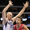 Photo - Dallas Mavericks center Chris Kaman (35) defends as Houston Rockets forward Chandler Parsons (25) tries to drive to the basket during the first quarter of an NBA basketball game, Wednesday, Jan. 16, 2013, in Dallas. (AP Photo/John F. Rhodes)