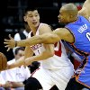 Oklahoma City\'s Derek Fisher defends Houston\'s Jeremy Lin during Game 3 in the first round of the NBA playoffs between the Oklahoma City Thunder and the Houston Rockets at the Toyota Center in Houston, Texas, Sat., April 27, 2013. Photo by Bryan Terry, The Oklahoman