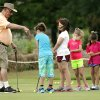 Photo -  Volunteer Henry Drury gives putting lessons during a free junior golf clinic at Westwood Golf Course. PHOTO BY STEVE SISNEY, THE OKLAHOMAN  <strong>STEVE SISNEY -   </strong>