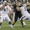 Photo - Central Florida quarterback Blake Bortles (5) throws as teammate Joey Grant (55) blocks against Baylor defensive tackle Trevor Clemons-Valdez during the second half of the Fiesta Bowl NCAA college football game, Wednesday, Jan. 1, 2014, in Glendale, Ariz. (AP Photo/Matt York)