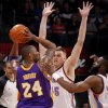 Oklahoma City\'s Cole Aldrich (45) and James Harden (13) defend Los Angeles\' Kobe Bryant (24) during an NBA basketball game between the Oklahoma City Thunder and the Los Angeles Lakers at Chesapeake Energy Arena in Oklahoma City, Thursday, Feb. 23, 2012. Photo by Bryan Terry, The Oklahoman