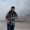 An Egyptian protester is seen during clashes with security forces, not pictured, near Tahrir Square in Cairo, Egypt, Sunday, Nov. 25, 2012. President Mohammed Morsi edicts, which were announced on Thursday, place him above oversight of any kind, including that of the courts. The move has thrown Egypt\'s already troubled transition to democracy into further turmoil, sparking angry protests across the country to demand the decrees be immediately rescinded. (AP Photo/Ahmed Gomaa)