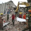 Workers carry a body that was trapped for almost a week in a collapsed garment factory building on Tuesday, April 30, 2013 in Savar, near Dhaka, Bangladesh. Emergency workers hauling large concrete slabs from the collapsed eight-story building said Tuesday they expect to find many dead bodies when they reach the ground floor. (AP Photo/Wong Maye-E)