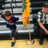 Russell Traut, age 3, plays on the bleachers inside Rinehart Fitness Center, while Billy Nash, (right) a member of Vietnam Veterans of America Chapter 751, waits for soldiers to arrive prior to a homecoming ceremony for soldiers returning from Iraq at Fort Sill on Tuesday, June 8, 2010. The Vietnam Veterans group, based in Lawton, Okla., have been to every deployment and homecoming since Sept. 11, 2001. Russell Traut and his family welcomed home Russell\'s father, SSgt. Michael Traut. Photo by John Clanton, The Oklahoman ORG XMIT: KOD
