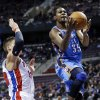 Oklahoma City Thunder forward Kevin Durant (35) drives past Detroit Pistons forward Jonas Jerebko (33), of Sweden, in the first half of an NBA basketball game in Auburn Hills, Mich., Monday, Nov. 12, 2012. (AP Photo/Paul Sancya)
