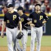 Photo - Dismayed Pittsburgh Pirates' Mark Melancon (35), Jayson Nix, and Jordy Mercer (10) look around, as a ball was deflected on a second base play allowing the winning Arizona Diamondbacks run to score during the 10th inning of a baseball game on Sunday, Aug. 3, 2014, in Phoenix.  The Diamondbacks defeated the Pirates 3-2. (AP Photo/Ross D. Franklin)