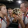 Forgan\'s Tyler McReynolds (21), right, kisses the gold ball trophy next to teammates Tanner Jones (33), left, and Tayler Eagan (23), middle, after the Class B boys basketball state tournament championship game between Graham and Forgan at State Fair Arena in Oklahoma City, Saturday, March 5, 2011. Forgan won, 81-47. Photo by Nate Billings, The Oklahoman
