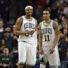 Boston Celtics forward Paul Pierce (34), left, and Celtics guard Courtney Lee (11), right, react seconds after the end of an NBA basketball game against the Los Angeles Clippers in Boston, Sunday, Feb. 3, 2013. The Celtics defeated the Clippers 106-104. (AP Photo/Steven Senne)