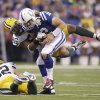 Indianapolis Colts quarterback Andrew Luck (12) is sacked by Green Bay Packers\' Mike Neal during the first half of an NFL football game in Indianapolis, Sunday, Oct. 7, 2012. (AP Photo/Michael Conroy)