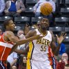 Indiana Pacers center Roy Hibbert (55) looks to the ball after having it knocked loose by Washington Wizards small forward Trevor Ariza, left, while driving to the basket during first-half action in an NBA basketball game in Indianapolis, Saturday, Nov. 10, 2012. (AP Photo/Doug McSchooler)
