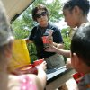 Pam Allen, an employee at the zoo, passes out free ice and water to Stephanie Hernandez and her family during a hot day at the Oklahoma City Zoo in Oklahoma City on Thursday, July 21, 2011. Photo by John Clanton, The Oklahoman