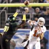 OSU\'s Zac Robinson passes the ball past Oregon\'s Ra\'Shon Harris during the Holiday Bowl college football between Oklahoma State and Oregon at Qualcomm Stadium in San Diego, Tuesday, Dec. 30, 2008. PHOTO BY BRYAN TERRY, THE OKLAHOMAN.